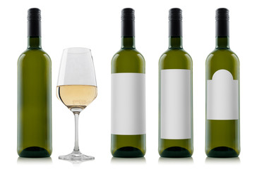 Mock-up sample of filled white wine bottles with different shaped blank white labels and a glass of wine isolated on white background for individual designs and graphics