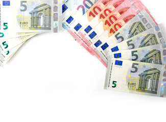 Euro currency, notes five, ten and twenty euros on a white background.