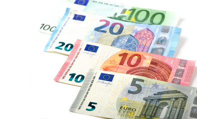 Euro currency on a white background. The denominations are five, ten, twenty and one hundred euros.
