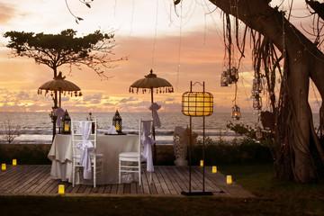 Fototapeta Beautiful romantic table for two set up, sunset time, tropical style obraz