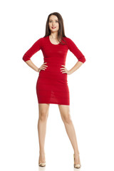 Young lady in red short dress on white baclground