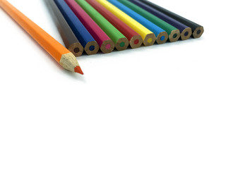 Orange pencil on background of other colored pencils isolated on white background