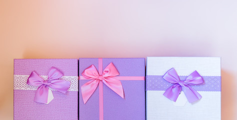 Gifts border on pastel background. Top view with copy space.