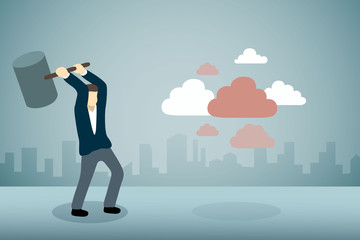 Businessman breaking group of cloud with hammer