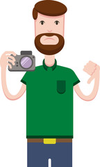 An angry bearded man in a green T-shirt is holding a camera and showing a dislike