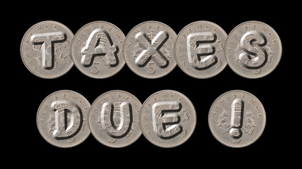 TAXES DUE written with old British coins on black background