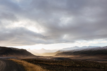 Mountain road leading to the peaks in Iceland.