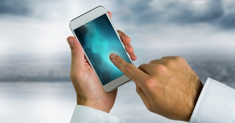 hand touching phone with blue gradient