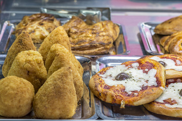 "Sicilian ""Arancino"" a typical street food from Sicily. Delicious rice balls made with fried rice."