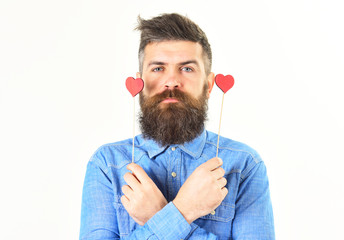 Brutal man with long beard and red hearts.