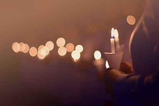 The nurse is showing the power of candlelight to commemorate those who have valued the past.