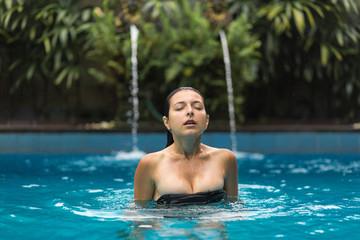 Wet woman in pool