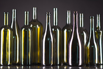 a lot of bottles on a green background