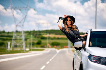 woman posing on car window