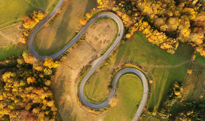 Aerial landscape - windy road in autumn scenery