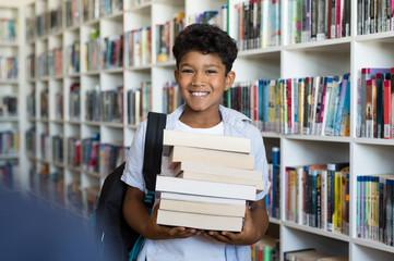 Elementary school boy holding books