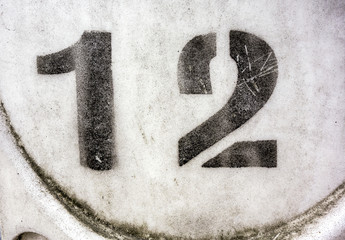 Written Wording in Distressed State Typography Found Number 12 Twelve