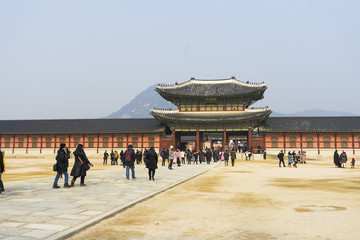 Wall Murals Beijing Gyeongbokgung palace with a lot of people in Seoul, South Korea.