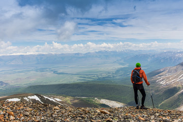 Man hiker on top of a mountain