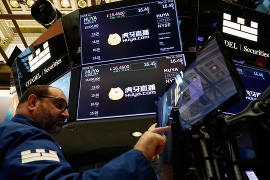 Huya Inc. logos appear on computer monitors during the company's IPO at the New York Stock Exchange (NYSE) in New York