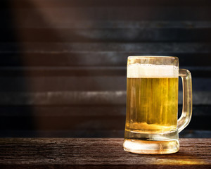 Glass of Beer on Wooden Table in Pub or Restaurant