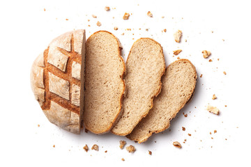 Sliced bread isolated on a white background. Bread slices and crumbs viewed from above. Top view Fototapete