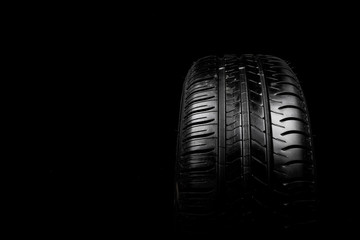 Car tyre isolated on a black background