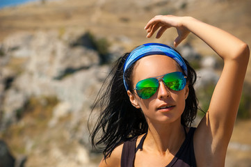 beautiful portrait of a girl with glasses traveler