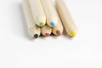 colored pencils in different colors on white background