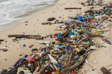polluted beach  - plastic waste, trash  and garbage closeup