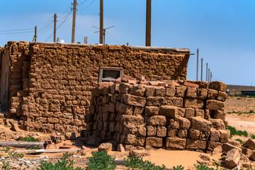 Old adobe house in semi-desert