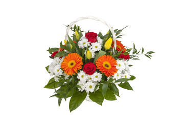 White basket with flowers. A bunch of colorful flowers for a birthday party. Woven basket, roses and tulips.