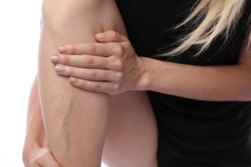 Painful varicose and spider veins on female legs. Woman massaging tired legs