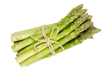 Bundle of fresh green asparagus shoots, also sparrow grass. Cultivated Asparagus officinalis. Spring vegetable with thick stems and closed buds. Food photo close up from above on white background.