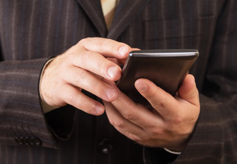 Smartphone in the hands of a man, closeup