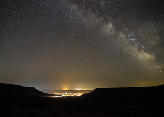 Milky Way above with light pollution from nearby small town