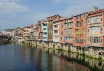 Castres, Midi Pyrenees, France - August 2, 2017: View of the canal that crosses the city of Castres with the old buildings