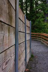wood wall along a path
