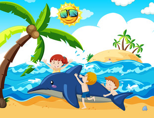Kids and inflatable dolphin at the beach