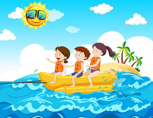 Children Riding Banana Boat at the Beach