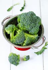 Fresh broccoli on wooden background