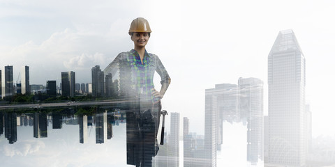 Builder woman against cityscape