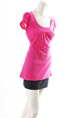Short pink mini dress on mannequin full body shop display. Woman fashion styles, clothes on white studio background.