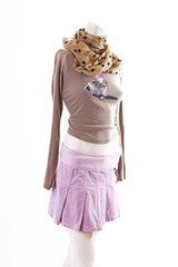 Short shirt purple skirt on mannequin full body shop display. Woman fashion styles, clothes on white studio background.