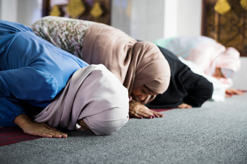 Muslim women praying in the mosque during Ramadan