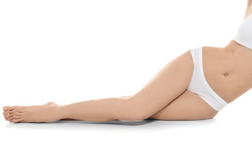 Young woman showing smooth silky skin after epilation on white background