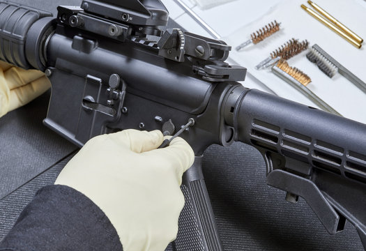 Diassembling an AR- 15 Rifle