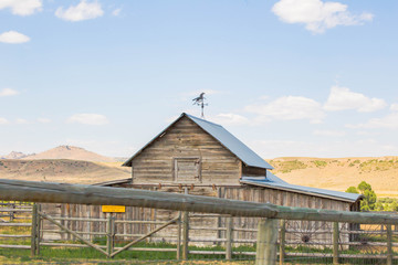 Farm home or building in rural midwest landscape. Summer day setting in Montana, USA.