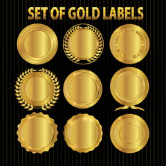 collection of elegant black and golden design elements - shields, labels, seals, banners, badges, scrolls and ornaments
