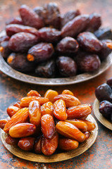 Set of various of dried dates or kurma in a vintage plates.